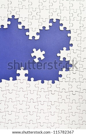Plain white jigsaw puzzle. (Mount in dark blue)