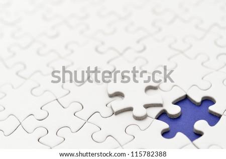 Plain white jigsaw puzzle. (Mount in dark blue)