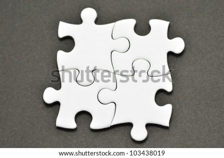Plain white jigsaw puzzle, on Black background.