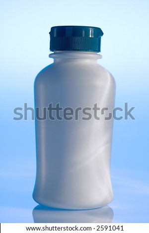 Plain white plastic pill bottle on blue