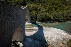 Plaka Bridge, the bridge was the starting point for rafting and canoeing on Arachthos River. It is located at the borders of Arta and Ioannina prefectures, above the waters of Arachthos River.