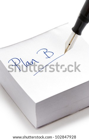 Plan B written in ink on a stack of post it notes