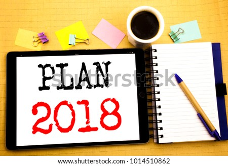 Plan 2018. Business concept for Planning Strategy Action Plan Written on tablet, wooden background with sticky note and pen #1014510862