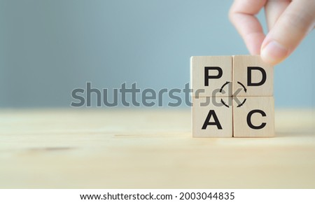 Plan do check action concept , PDCA on wooden cube block with grey background ;copy space.  Deming cycle concept business management method to control and continuous improvement of process and product Stok fotoğraf ©