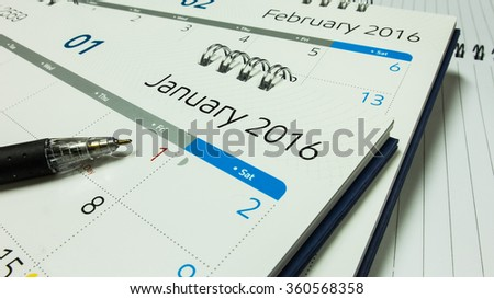 Plan for New Year 2016, Calendar of 2016 with Pen and Notebook on Office Desk #360568358
