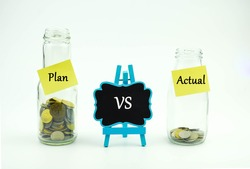 Plan vs Actual text written on glass jar. Business or Financial concept.