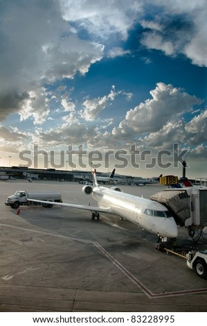 Plane Boarding - Airplane in tarmac ready to be boarded by flying passengers and crew - stock photo