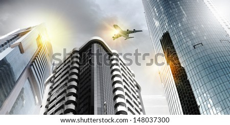 Plane flying above skyscrapers. Business travel concept #148037300