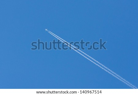 plane is flying on a blue sky #140967514