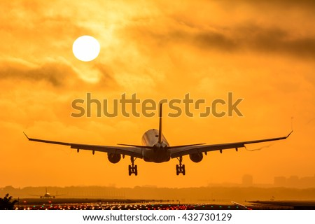 Plane is flying to the airport during a foggy sunrise. Nice vortex behind the wings of the airplane.