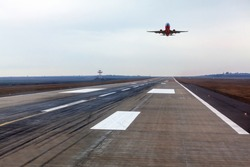 Plane is landing . Airplane over the runway strip
