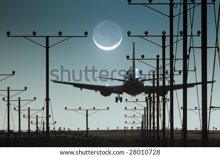 Plane landing or departing in airport at night