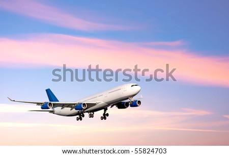 Plane. Sunrise