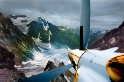 plane surrounded by mountains.