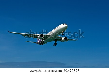 plane with landing gear against the blue sky - stock photo