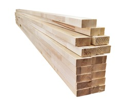Planed orthogonal edge dried 100x50mm timber in pack. Spruce wood. Isolated on white background