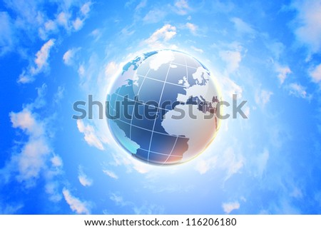 Planet earth against blue cloudy sky background