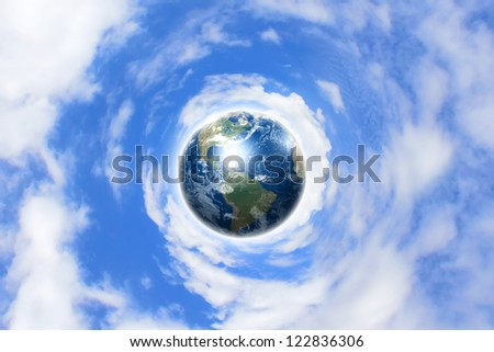 Planet earth against blue cloudy sky background. Elements of this image furnished by NASA.