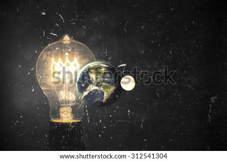 Planet earth and lightbulb for global power and energy concept, light bulb, Elements of image from NASA