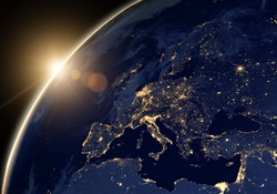 Planet Earth at night, view of city lights showing human activity in Europe and Middle East from space. World map on dark globe at sunrise on satellite photo. Elements of this image furnished by NASA.