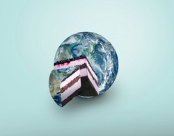 Planet earth cake, concept. Blue planet earth pie pieces on blue background. Food and sweets creative idea. Sugar and life
