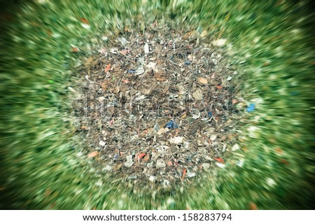 planet earth environmental concept of decomposing landfill garbage - no visible trademarks - stock photo