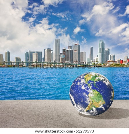 Planet Earth goes on vacation in Miami Florida. Conceptual vacations travel abstract montage