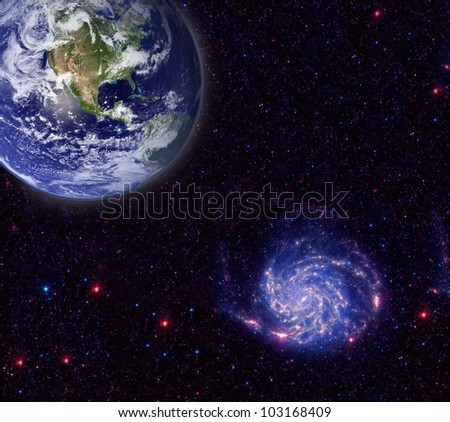 Planet earth in the foreground and galaxy in the background. Elements of this image furnished by NASA.