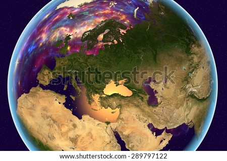 Planet Earth on background with stars; Earth from space showing Europe, Arabian peninsula, Africa on globe in the day time; galaxies are reflected in water; elements of this image furnished by NASA