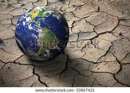 Planet Earth on dry soil, photo of the earth from nasa