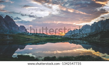 Planet earth showing its beauty of alpine mountain lake at sunrise #1342547735