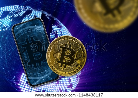 Planet earth, telephone with bitcoin on a blue background. Bitcoin is not in the foreground in the foreground. #1148438117