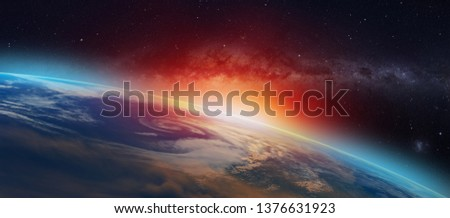 """Planet Earth with a spectacular sunset in the background milky way galaxy """"Elements of this image furnished by NASA""""  #1376631923"""