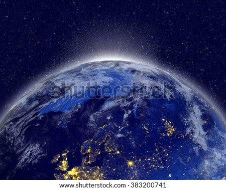 Planet earth with appearing sunlight. Visible city lights.  Elements of this image furnished by NASA. #383200741