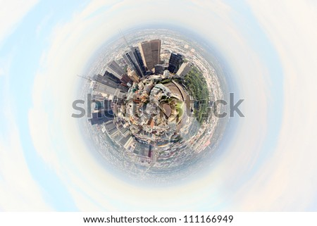 Planet earth with city on it against sky background