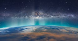 Planet Earth with milkyway galaxy. A beautiful green and blue aurora dancing over the world