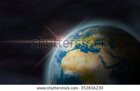 Planet earth with sunrise in space.The Earth texture of this image furnished by NASA.