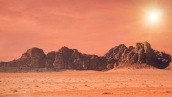 Planet Mars like landscape - Photo of Wadi Rum desert in Jordan with red colour filter and added sun, this location was used as set for many science fiction movies