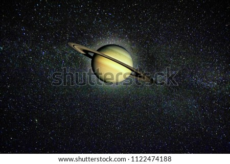 Planet Saturn against the stars of the Milky Way. Elements of this image furnished by NASA