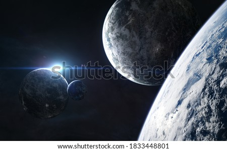 Photo of  Planets in light of blue star. Beautiful deep space. Science fiction. Elements of this image furnished by NASA