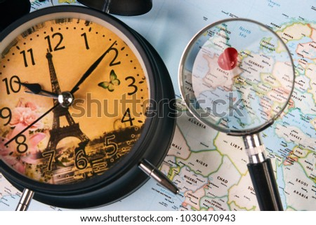 Free photos paris pinned on a map of europe avopix planing for travel to france paris with worldmap globe magnifying glass and alarm clock travel gumiabroncs Images