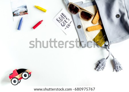 planing trip with child with toys and glasses white background top view space for text #680975767