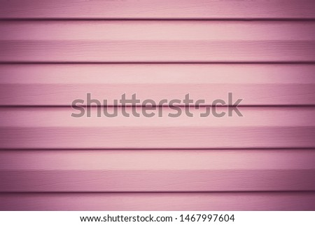 Plank - timber. Painted wooden planks. Pink, purple facing wood surface. Striped violet panel. Slats texture. Copy space. Decorative frame in the lines for design. Vignetting background.