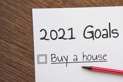 planner of goals and plans for 2021, a sheet of paper with the inscription buy a house from to do list, planning concept