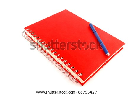 planner with red cover and blue pen on white background