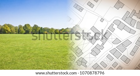 Planning a new city - concept image with hand drawing an imaginary cadastral map of territory with buildings, fields and roads against a green area