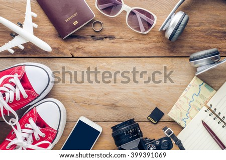 Planning for trip clothing and accessories on wood floor #399391069