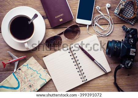 Planning for trip clothing and accessories on wood floor #399391072
