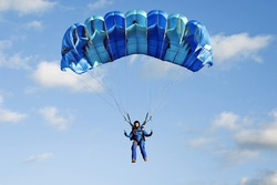 Planning girl-parachutist in blue overalls