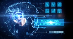 Planning marketing strategy. Business, Technology, Internet and network concept. Young businessman shows the word: Marketing automation
